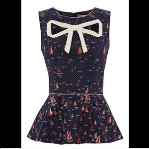 Trolled Dolly Peplum top with cutout